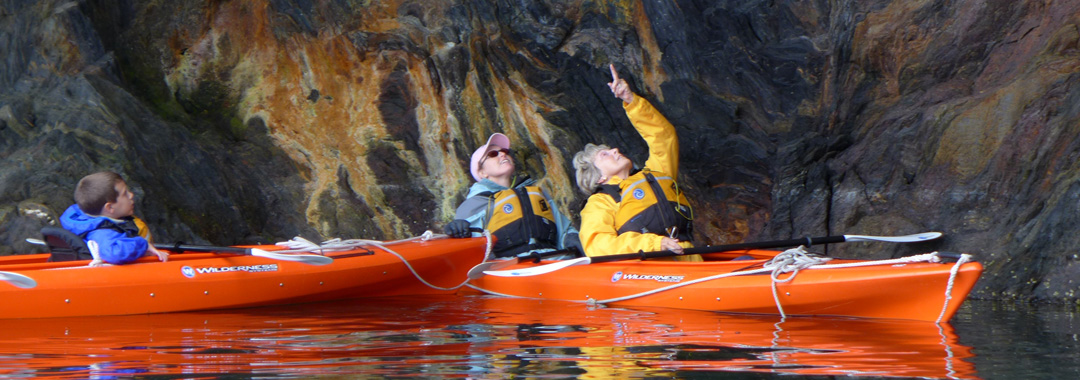 Kayaking while on a small boat cruise in southeast Alaska